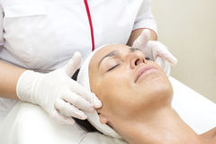 Process of massage and facials. In beauty salon Royalty Free Stock Image