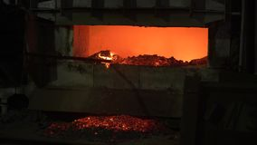 The process of melting metal at the plant in the furnace. Workers remove the slag, to obtain a pure alloy. Metallurgical production stock video