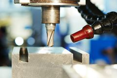 Process of metal machining by mill Stock Image