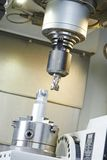 Process of metal machining by mill Royalty Free Stock Photo