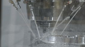 The process of milling a metal part on a CNC machine. stock video footage