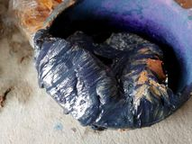 Process mix material for preparing natural colors Mauhom or indigo color of Indigenous and wisdom knowledge of thai people. At Sakom nakorn and Phrae in basin stock photos