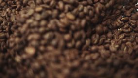 The process of mixing freshly roasted coffee beans. The process of cooling freshly roasted coffee beans. No people stock footage