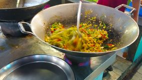 Cooking of vegetable omelette, Tanin market stall, Chiang Mai, Thailand