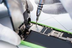Process of mobile phone repair Royalty Free Stock Images