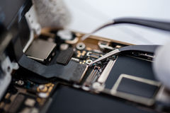 Process of mobile phone repair. Stock Images