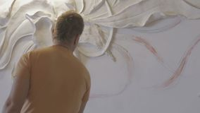 The process of molding stucco and bas-relief on the wall stock video footage