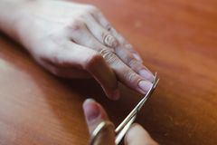 The process of nail clippingl scissors. Hand care concept. royalty free stock photo