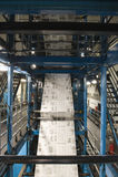 Process Of Newspaper Production. Closeup of newspaper production and printing process Royalty Free Stock Photo