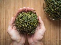 Process Of Fermentation Of Tea. Manual Processing Ivan Tea Fermentation. Stock Photo
