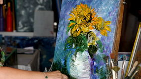 Process of oil painting, artist paints picture on canvas. Sunflowers. Process of oil painting in studio, artist paints picture on canvas. Sunflowers stock video