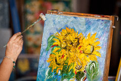 Process of oil painting, artist paints picture on canvas. Sunflowers. Process of oil painting in studio, artist paints picture on canvas. Sunflowers stock photography