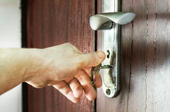 The process of opening the lock by key Stock Photo