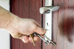 The process of opening the lock by key Stock Images