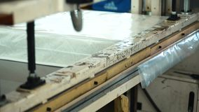 Process of packaging mattresses in workshop in factory indoors. stock video footage