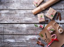 Process of packing boxes with Christmas gifts presents Stock Photography