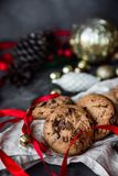 Homemade Chocolate chip cookies decorated with red ribbon and christmas decoration. Freshly baked on rustic table. Selective Focus stock photos