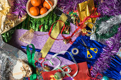 The process of packing Christmas holiday gifts. Wrapping paper, ribbon, Christmas decorations. View from above. Royalty Free Stock Images