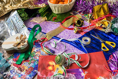 The process of packing Christmas holiday gifts. Wrapping paper, ribbon, Christmas decorations. View from above. Stock Photo