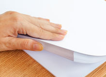 The process of paging white office paper with your fingers Royalty Free Stock Image