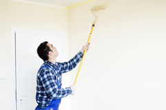 The process of painting the walls in the room Royalty Free Stock Images