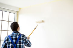 The process of painting the walls in the room Stock Photo