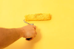 The process of painting the walls in yellow color Royalty Free Stock Photos
