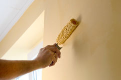 The process of painting the walls in yellow color Royalty Free Stock Photography