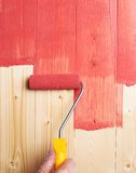 Process of painting the wood boards Royalty Free Stock Photography