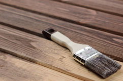 The process of painting wood surfaces with a brush Royalty Free Stock Images