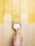 Process of painting wooden boards royalty free stock photo