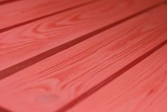 Wood Texture, coral-red color Wooden Plank Grain Background, Desk in Perspective Close Up, Striped Timber, Old Table or Floor Boar. The process of painting stock photography