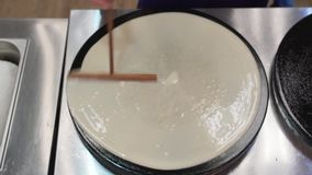 Process of pancake frying close up view from above stock video