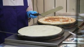 Process of pancake turning on one side to other stock footage
