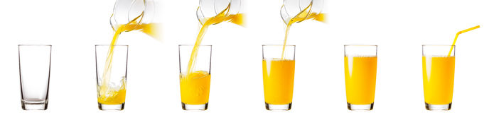 Process of pouring orange juice into a glass Stock Images