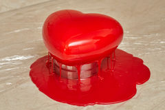 Process of pouring red glaze on heart shape form cake. Process of pouring red glaze on heart shape form mousse cake, homemade food Royalty Free Stock Images