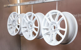 Process of powder coating auto wheels. In workshop stock photo