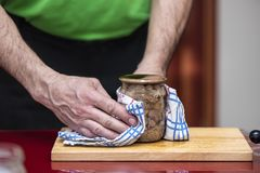 Process of preparation homemade pork stew. Canned pork meat in jar stock photography