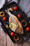 The process of preparing grilled dorado fish on the grill. verti Royalty Free Stock Photography