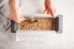 Cooking vegan raw cake, cashew cake on white background. The process of preparing raw vegan cake, cashew cake on a white background stock photography