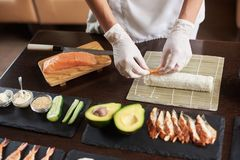 Process of preparing rolling sushi stock photography