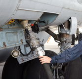 The process of refueling airplane in airport. Fuel hose is inserted. Hand with hose royalty free stock photos