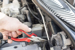 The process of repairing vehicle using pliers Stock Photos