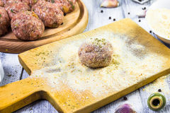Process rolling raw meatballs breadcrumbs Royalty Free Stock Photos