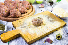 Process rolling raw meatballs breadcrumbs Royalty Free Stock Image