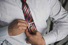 Process of setting of a tie 2484. Stock Photo