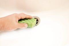 The process of soaking the sponge Stock Photos