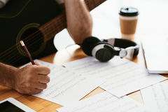 Process of song writing. Hands of songwriter working on new composition, selective focus Stock Photography
