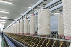Process of spinning yarn onto spool Royalty Free Stock Images