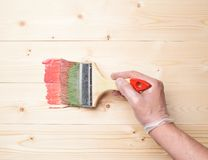 Process of starting to paint wooden boards Stock Photos
